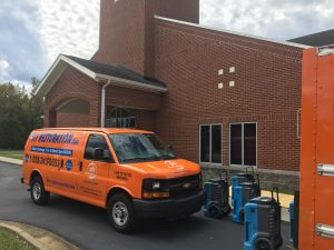 side-angle-water-damage-restoration-van